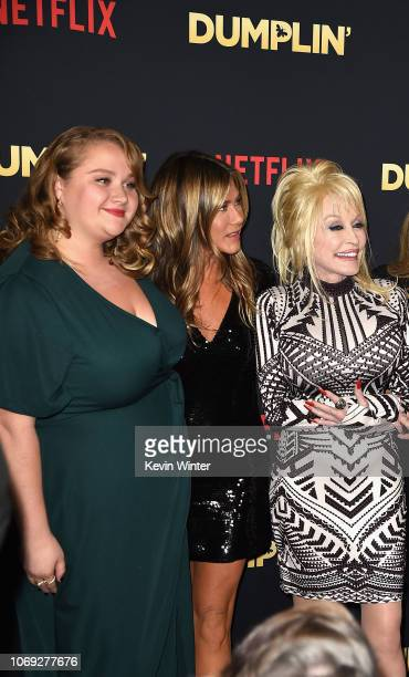 Actors Danielle Macdonald and Jennifer Aniston and singer Dolly Parton attend the premiere of Netflix's 'Dumplin'' at TCL Chinese 6 Theatres on...