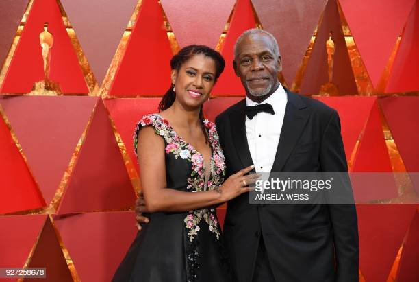 US actors Danny Glover and his wife Eliane Cavalleiro arrive for the 90th Annual Academy Awards on March 4 in Hollywood California / AFP PHOTO /...