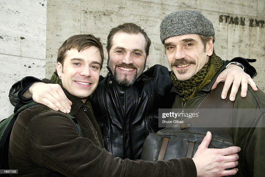 Actors Danny Gurwin, Marc Kudisch, and Jeremy Irons hug after the opening weekend of the New York City Opera's production of Stephen Sondheim's 'A Little Night Music' at The New York State Theater at the Lincoln Center on March 8, 2003 in New York City.