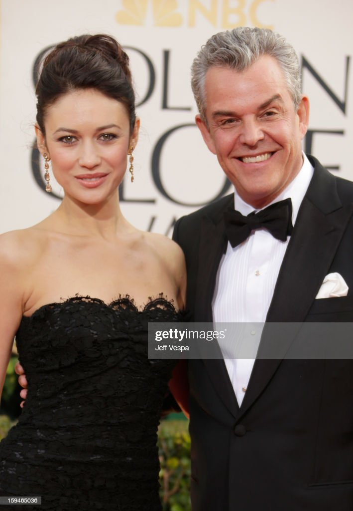 Actors Danny Huston and Olga Kurylenko arrive at the 70th Annual Golden Globe Awards held at The Beverly Hilton Hotel on January 13, 2013 in Beverly Hills, California.