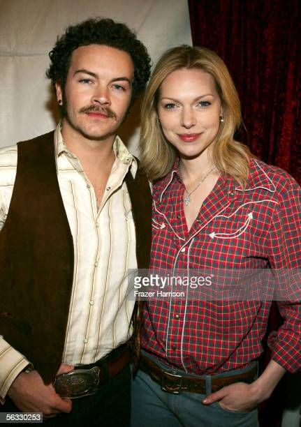Actors Danny Masterson and Laura Prepon pose backstage during the Church of Scientology's An Evening of Holiday Joy benefiting the Hollywood Police...
