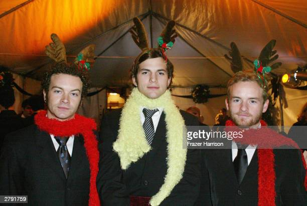 Actors Danny Masterson Ashton Kutcher and Chris Masterson pose backstage at the Church of Scientology's 11th Annual Christmas Stories Fundraiser to...