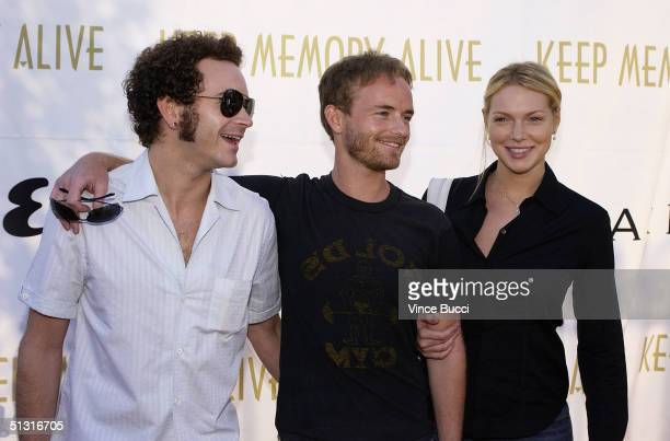 Actors Danny Masterson Chris Masterson and Laura Prepon attend the Esquire House Los AngelesBvlgari Celebrity Poker Night on September 16 2004 in...