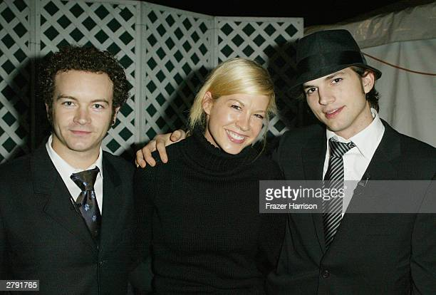 Actors Danny Masterson Jenna Elfman and Ashton Kutcher pose backstage at the Church of Scientology's 11th Annual Christmas Stories Fundraiser to...