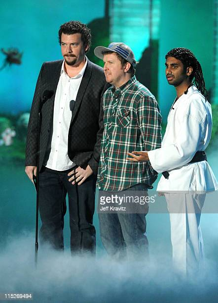 Actors Danny McBride Nick Swardson and Aziz Ansari speak onstage during the 2011 MTV Movie Awards at Universal Studios' Gibson Amphitheatre on June 5...