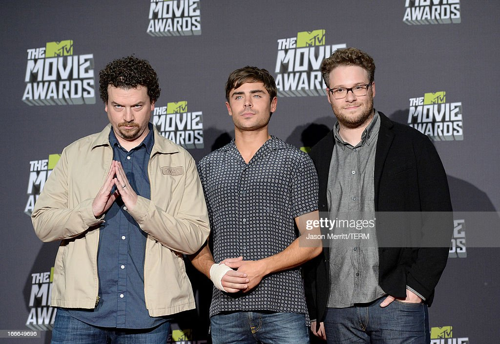 Actors Danny McBride, Zac Efron and Seth Rogen pose in the press room during the 2013 MTV Movie Awards at Sony Pictures Studios on April 14, 2013 in Culver City, California.