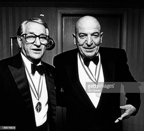 Actors Danny Thomas and Telly Savalas attend Ellis Island Medals of Honor Awards Dinner on December 9 1990 at Ellis Island in New York City