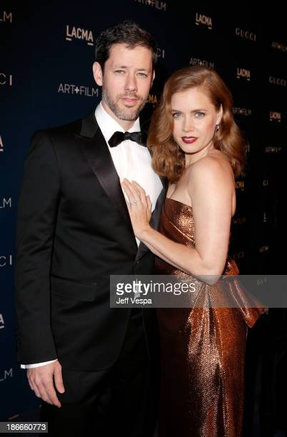 Actors Darren Le Gallo and Amy Adams, wearing Gucci, attend the LACMA 2013 Art + Film Gala honoring Martin Scorsese and David Hockney presented by...