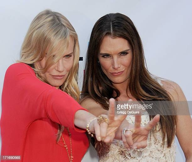 Actors Daryl Hannah and Brooke Shields arrive at the Los Angeles premiere of 'The Hot Flashes' at ArcLight Cinemas on June 27 2013 in Hollywood...