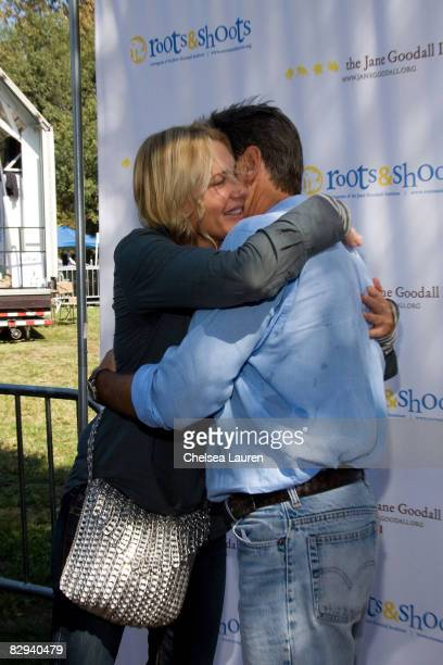Actors Daryl Hannah and Pierce Brosnan greet each other during Roots Shoots Day of Peace at Griffith Park on September 21 2008 in Los Angeles...