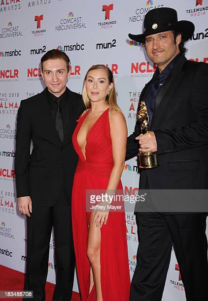 Actors Daryl Sabara Alexa Vega and director Robert Rodriguez pose in the press room at the 2013 NCLA ALMA Awards at Pasadena Civic Auditorium on...