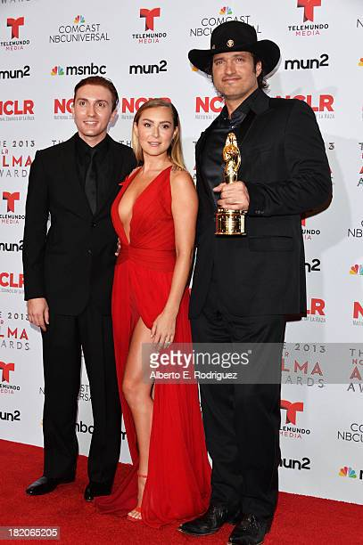 Actors Daryl Sabara and Alexa Vega and director Robert Rodriguez pose with Anthony Quinn Award for Industry Excellence at the Winner's Walk during...