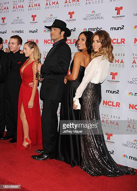 Actors Daryl Sabara and Alexa Vega director Robert Rodriguez and actors Rosario Dawson and Jessica Alba pose in the press room at the 2013 NCLA ALMA...