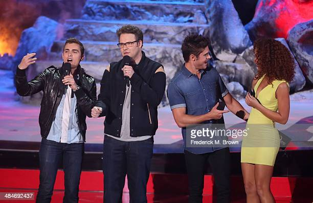 Actors Dave Franco Seth Rogen Zac Efron and Tiffany Luce speak onstage at the 2014 MTV Movie Awards at Nokia Theatre LA Live on April 13 2014 in Los...