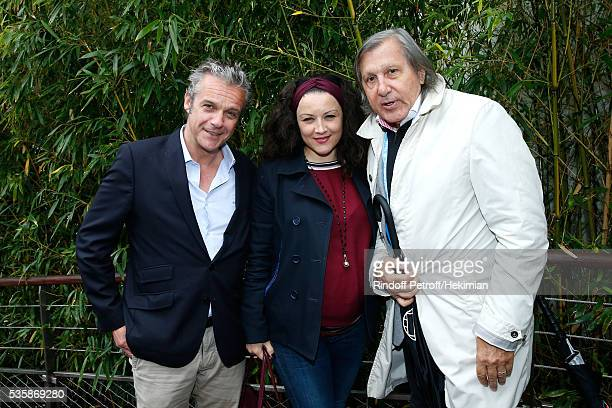 Actors David Brecourt his companion Alexandra Sarramona and Tennis player Ilie Nastase attend Day Nine of the 2016 French Tennis Open at Roland...