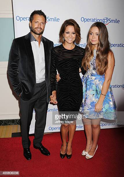 Actors David Charvet Brooke BurkeCharvet and daughter Neriah Fisher attend the 2014 Operation Smile Gala at the Beverly Wilshire Four Seasons Hotel...