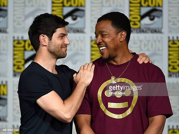 Actors David Giuntoli and Russell Hornsby attend the Grimm season five panel during ComicCon International 2015 at the San Diego Convention Center on...