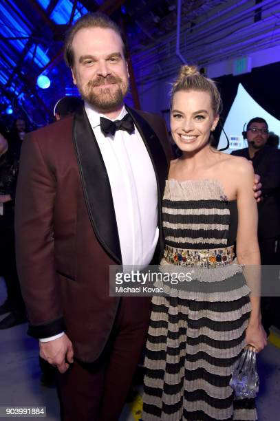 Actors David Harbour and Margot Robbie attend Moet Chandon celebrate The 23rd Annual Critics' Choice Awards at Barker Hangar on January 11 2018 in...
