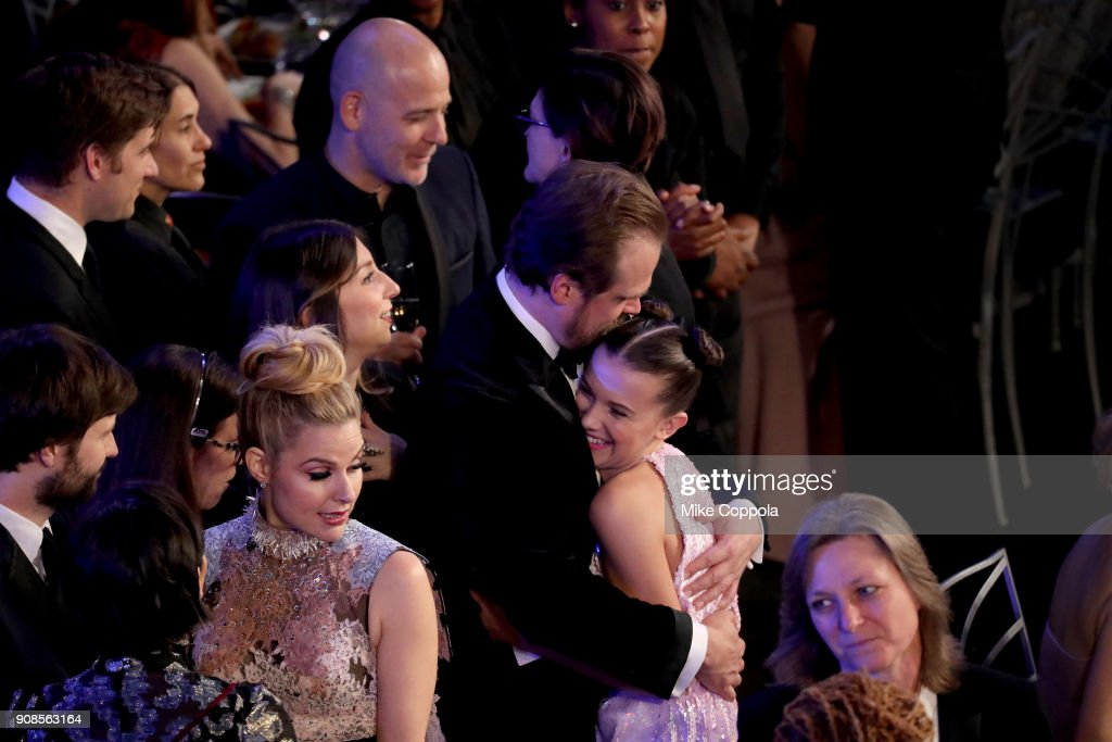Actors David Harbour (L) and Millie Bobby Brown attend the 24th Annual Screen Actors Guild Awards at The Shrine Auditorium on January 21, 2018 in Los Angeles, California. 27522_014