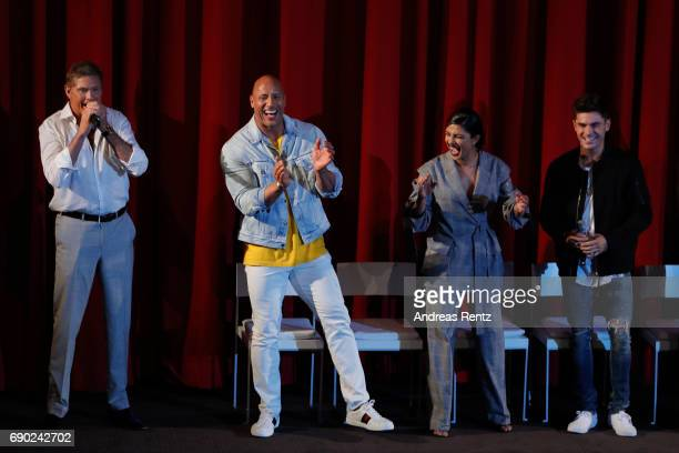 Actors David Hasselhoff Dwayne Johnson Priyanka Chopra and Zac Efron attend the European premiere of 'Baywatch' at Cinestar on May 30 2017 in Berlin...
