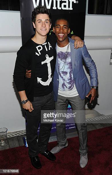 Actors David Henrie and Brandon Mychal Smith arrive at the 21st birthday bash of actor Brandon Mychal Smith presented by Vivitar and DJ Hero on June...