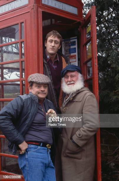 Actors David Jason Nicholas Lyndhurst and Buster Merryfield pictured in a telephone box during the filming of the episode 'The Frog's Legacy' of the...