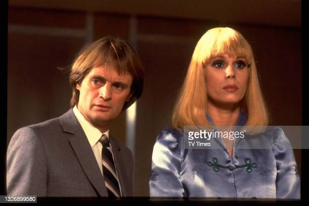 Actors David McCallum and Joanna Lumley in character on the set of science fiction series Sapphire And Steel, circa 1981.