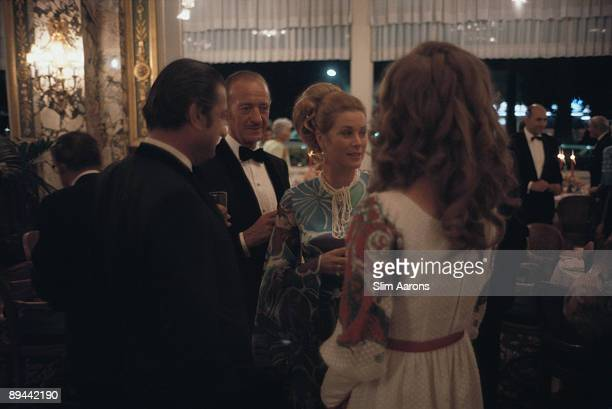 Actors David Niven and Princess Grace of Monaco attend a party in Monte Carlo August 1970