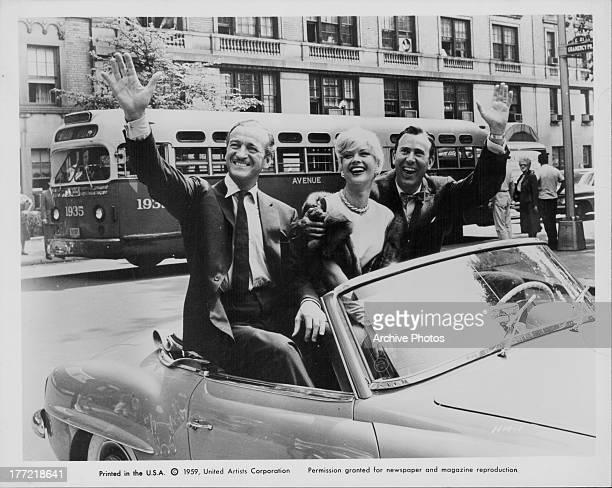 Actors David Niven Carl Reiner and Monique van Vooren publicly advertising their new movie 'Happy Anniversary' 1959