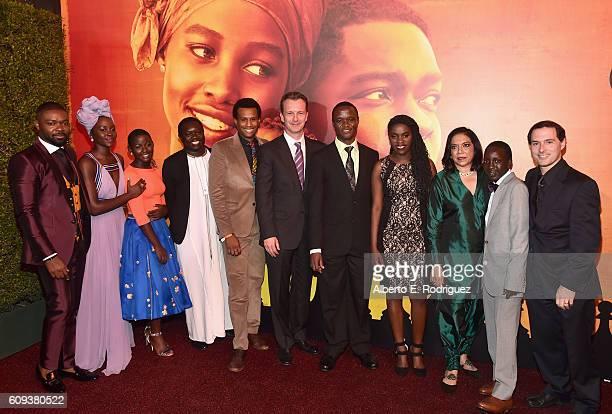 Actors David Oyelowo Lupita Nyong'o and Madina Nalwanga chaperone Mark Mugwana Executive Vice President of Production The Walt Disney Studios Tendo...