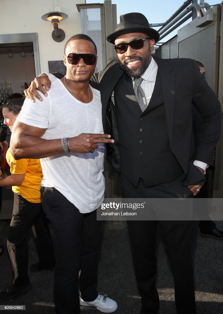 Actors David Ramsey (L) and Cress Williams at BuzzFeed & The CW Present SRSLY The Best Damn Superhero Party! on July 21, 2017 in San Diego, California.