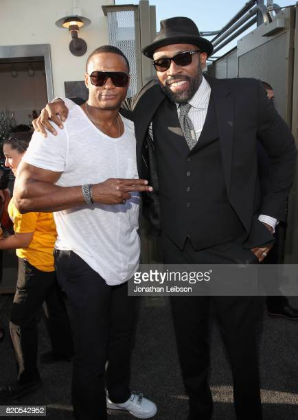 Actors David Ramsey and Cress Williams at BuzzFeed The CW Present SRSLY The Best Damn Superhero Party on July 21 2017 in San Diego California