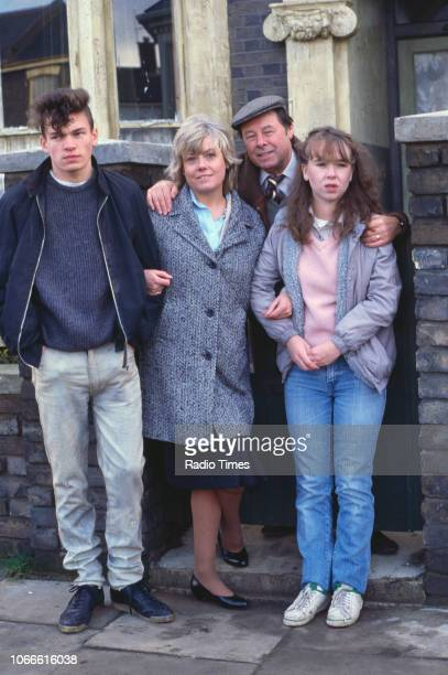Actors David Scarboro Wendy Richard Bill Treacher and Susan Tully pictured on the exterior set of the BBC soap opera 'EastEnders' circa 1986