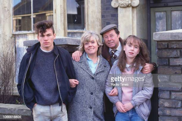 Actors David Scarboro Wendy Richard Bill Treacher and Susan Tully pictured on the exterior set of the BBC soap opera 'EastEnders' December 18th 1985