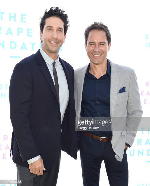Actors David Schwimmer and Eric McCormack arrive at The Rape Foundation's Annual Brunch on October 7 2018 in Beverly Hills California