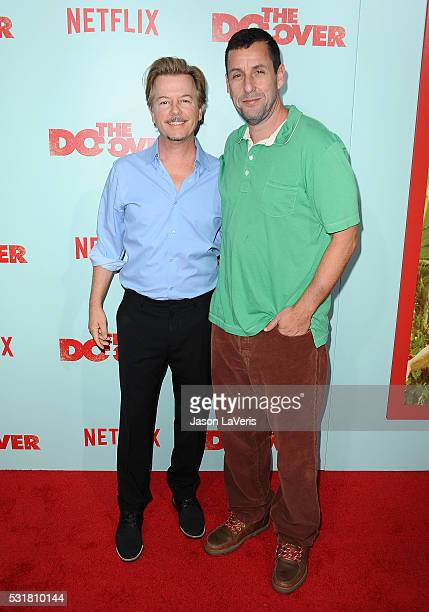 Actors David Spade and Adam Sandler attend the premiere of The Do Over at Regal LA Live Stadium 14 on May 16 2016 in Los Angeles California