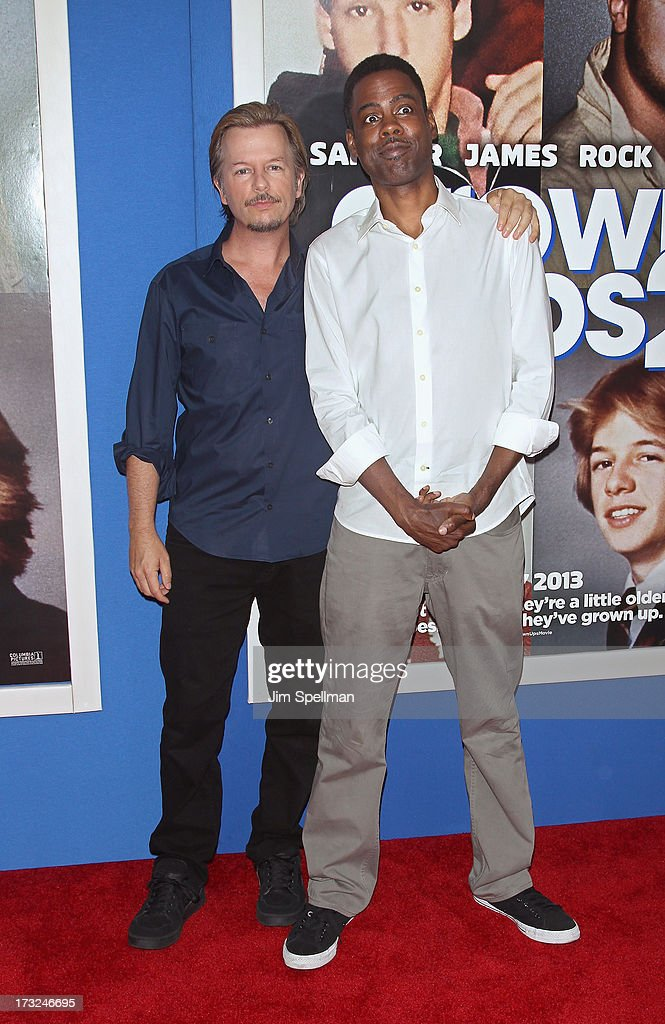 Actors David Spade and Chris Rock attend the 'Grown Ups 2' New York Premiere at AMC Lincoln Square Theater on July 10, 2013 in New York City.