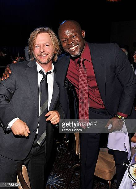 Actors David Spade and Djimon Hounsou attend the 2009 GRAMMY Salute To Industry Icons honoring Clive Davis at the Beverly Hilton Hotel on February 7...