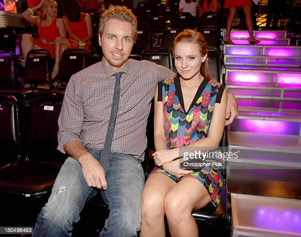 Actors Dax Shepard and Kristen Bell attend the 2012 Do Something Awards at Barker Hangar on August 19, 2012 in Santa Monica, California.