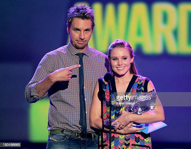 Actors Dax Shepard and Kristen Bell speak onstage during the 2012 Do Something Awards at Barker Hangar on August 19 2012 in Santa Monica California