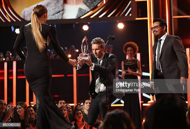 Actors Dax Shepard and Michael Pena present the Favorite TV Crime Drama Actress award for 'Shades of Blue' to actress Jennifer Lopez onstage during...