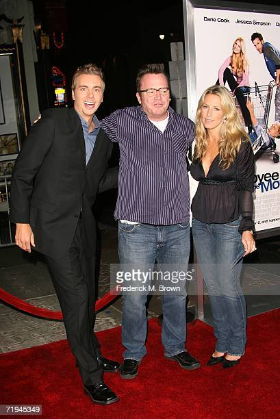 Actors Dax Shepard Tom Arnold and a unidentified guest attends the film premiere of 'Employee of the Month' at Graumans Chinese Theatre on September...