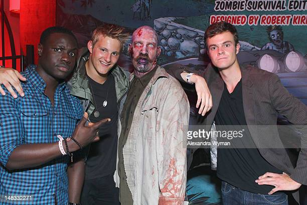 Actors Dayo Okeniyi Alexander Ludwig and Jack Quaid attend 'The Walking Dead' 100th Issue BlackCarpet event powered by Hyundai and Future US at PETCO...