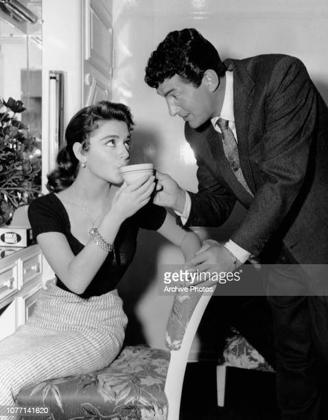 Actors Dean Martin and Anna Maria Alberghetti enjoy a coffee break on the set of the MGM film 'Ten Thousand Bedrooms' 1956
