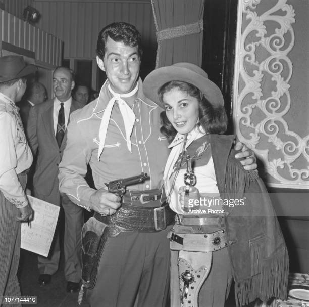 Actors Dean Martin and Pier Angeli dressed in old western attire circa 1955