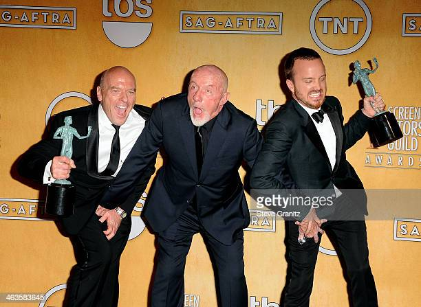 Actors Dean Norris, Jonathan Banks, and Aaron Paul pose in the press room during the 20th Annual Screen Actors Guild Awards at The Shrine Auditorium...