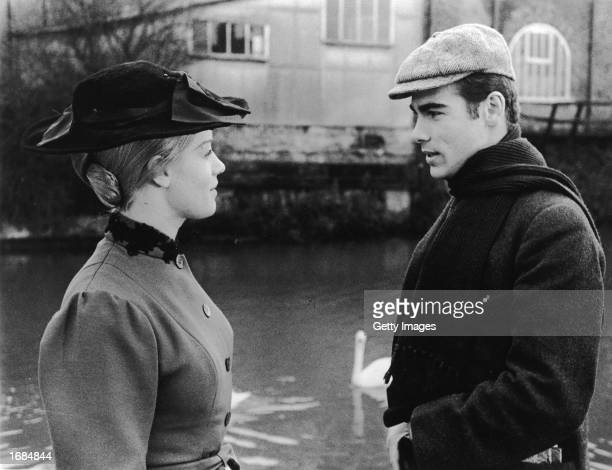 Actors Dean Stockwell and Mary Ure stand by a river in a still from the film, 'Sons And Lovers,' directed by Jack Cardiff, 1960.