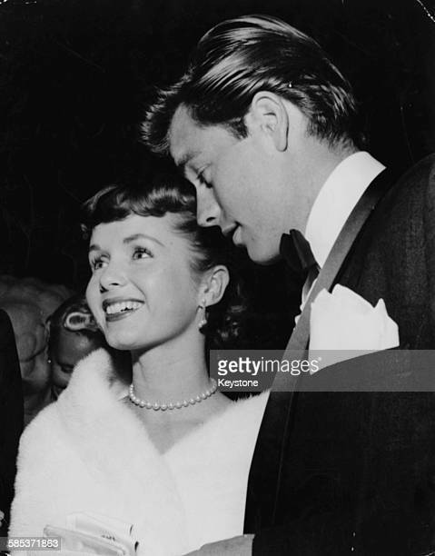 Actors Debbie Reynolds and Robert Wagner pictured at a party in Hollywood CA circa 1959