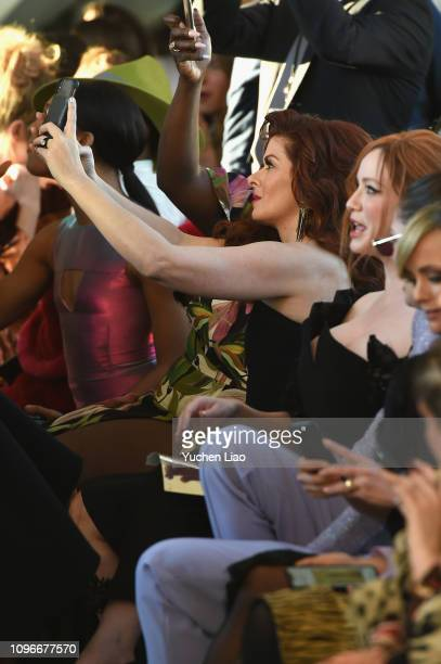 Actors Debra Messing and Danielle Brooks use mobile phones during the Christian Siriano front row during New York Fashion Week The Shows at Top of...