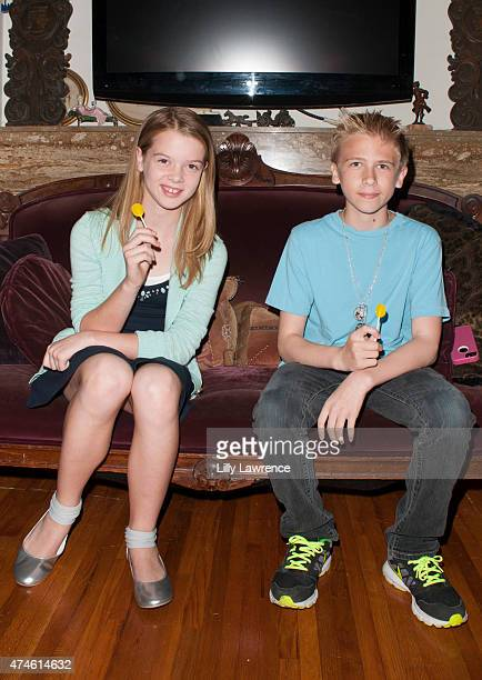 Actors Delaney Raye and Xander Russell enjoy Zollipops at The SAP - The Starving Artists Project - Backstage on May 23, 2015 in Los Angeles,...